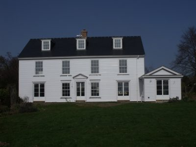 Rebuilding and restyling of existing dwelling severely damaged by fire, East Bergholt, Suffolk.